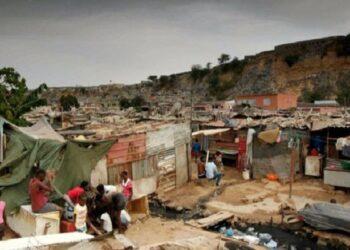 Residents at a slum