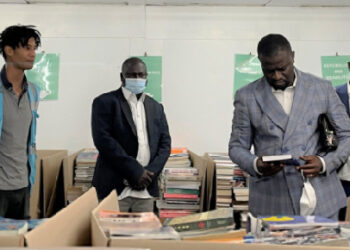 Frank Annoh-Dompreh, the member of Parliament for Nsawam Adoagyiri reading a book